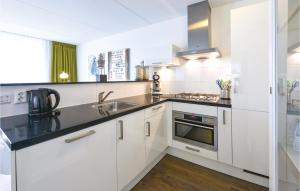 A kitchen or kitchenette at 6-12 pax