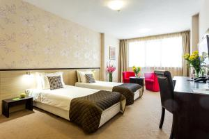 A bed or beds in a room at City Avenue Hotel by HMG