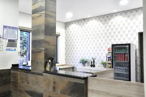 The lobby or reception area at Guadagnini Hotel