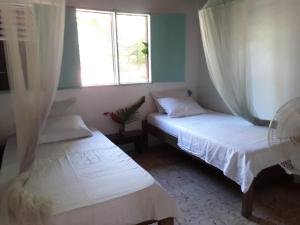 A bed or beds in a room at Clear River Hostel