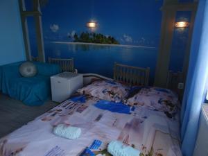 Łóżko lub łóżka w pokoju w obiekcie Willa SUNRISE