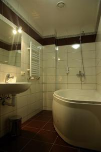 Ванная комната в Hotel Deluxe