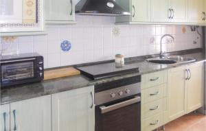 A kitchen or kitchenette at Four-Bedroom Holiday Home in La Manga del Mar Menor