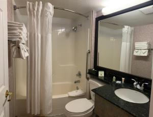 A bathroom at Pacific Inn & Suites Kamloops
