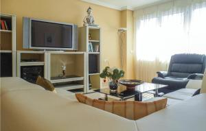 A television and/or entertainment center at Apartment in Alicante