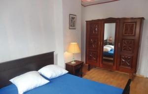 A bed or beds in a room at Holiday home Fitou AB-1323