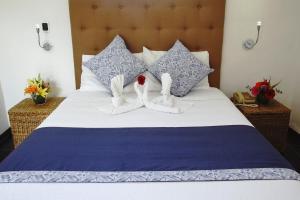 Cama o camas de una habitación en Hotel Los Milagros
