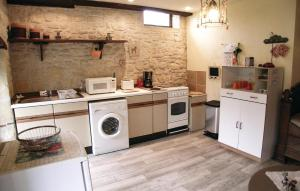 A kitchen or kitchenette at Holiday home La Fayolle O-565