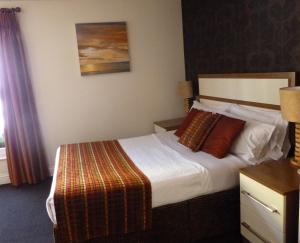 A bed or beds in a room at The White Lady Hotel