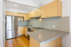 A kitchen or kitchenette at The Rooftop - A Bondi Beach Holiday Home