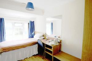 A bed or beds in a room at Stansted Inn