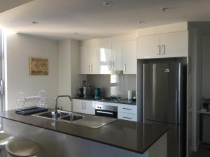 A kitchen or kitchenette at Church St Accommodation in Parramatta CBD