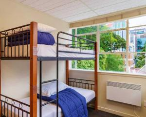A bunk bed or bunk beds in a room at Trek Global Backpackers