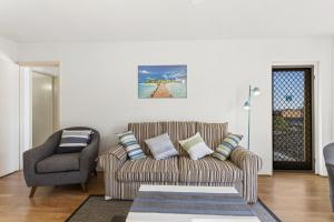 A seating area at Bay Blue @ Nelson Bay- just 3 minutes walk to Flypoint Beach and 10 minutes walk to Little Beach