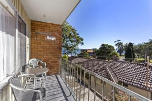 A balcony or terrace at Bay Blue @ Nelson Bay- just 3 minutes walk to Flypoint Beach and 10 minutes walk to Little Beach