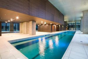 The swimming pool at or near A Cozy 2BR Apt Next to Southern Cross + City Views