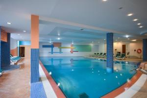 The swimming pool at or near Hunguest Hotel Répce Gold