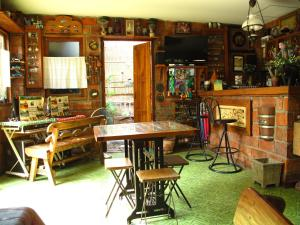 The lounge or bar area at P.Y. Guest House