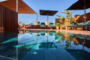 The swimming pool at or near Mon Boutique Hotel