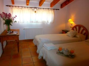 A bed or beds in a room at Finca El Corral