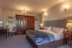 A bed or beds in a room at Castle Dargan Hotel