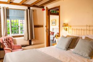 A bed or beds in a room at The Orangery Restaurant & Rooms