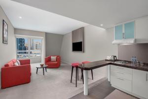 A kitchen or kitchenette at Leva Hotel and Suites, Mazaya Centre
