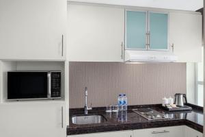 مطبخ أو مطبخ صغير في ليفا للشقق الفندقية
