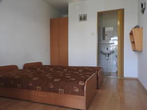 Łóżko lub łóżka w pokoju w obiekcie Kwatery u Rysia