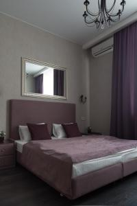 A bed or beds in a room at Nice Hotel