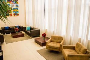 Uma área de estar em Hotel Maruá