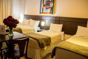 Cama ou camas em um quarto em Hotel Maruá
