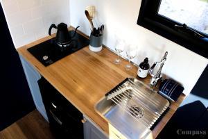A kitchen or kitchenette at Compass Hut