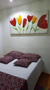 A bed or beds in a room at APTO - PETRÓPOLIS - RIO