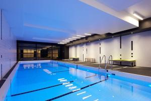 The swimming pool at or near A Cozy CBD Suite with City Views + Pool & Gym