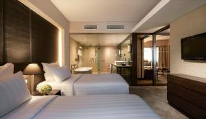 A bed or beds in a room at Pullman Jakarta Indonesia