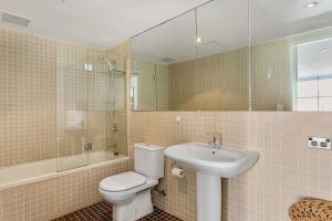 A bathroom at The Precinct - A Bondi Beach Holiday Home