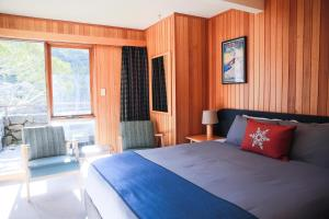 A bed or beds in a room at Thredbo Alpine Hotel