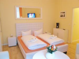 Кровать или кровати в номере City Guesthouse Pension Berlin