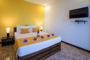 Ceyloni Panorama Resortにあるベッド