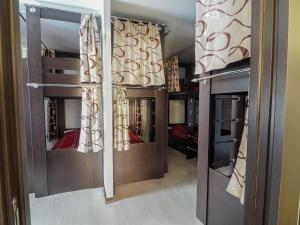 A bunk bed or bunk beds in a room at Хостел Красная стрекоза