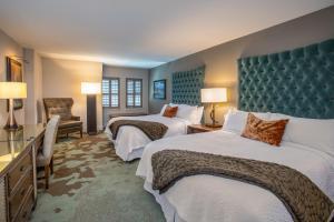 A bed or beds in a room at Grand Bohemian Hotel Asheville, Autograph Collection