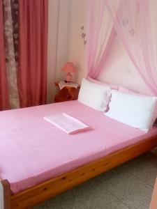 Ένα ή περισσότερα κρεβάτια σε δωμάτιο στο Maria Charalampaki Studios