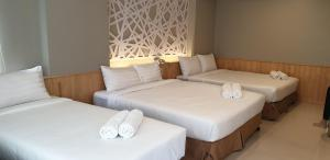 A bed or beds in a room at Alpine Suites Hotel