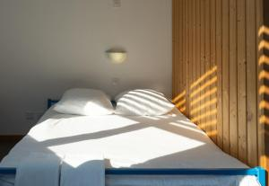 Ein Bett oder Betten in einem Zimmer der Unterkunft Mont-Fort Swiss Lodge