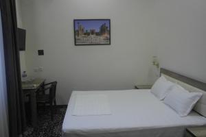 Orient Star Hotelにあるベッド