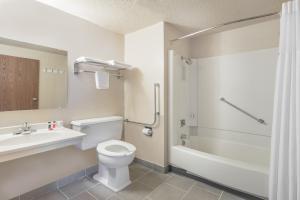 A bathroom at Super 8 by Wyndham Devils Lake