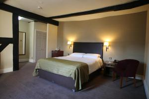 A bed or beds in a room at Castle and Ball by Greene King Inns