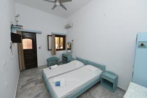 Ένα ή περισσότερα κρεβάτια σε δωμάτιο στο kyma studios