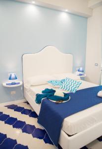 Letto o letti in una camera di Marilisa Holidays